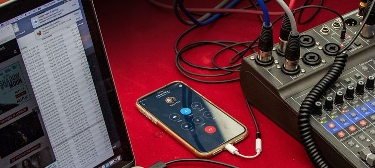 LiveTrak L-8 on table with laptop and iphone