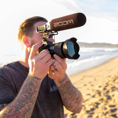 Videographer recording with a DSLR and a F1-SP on Venice Beach, California