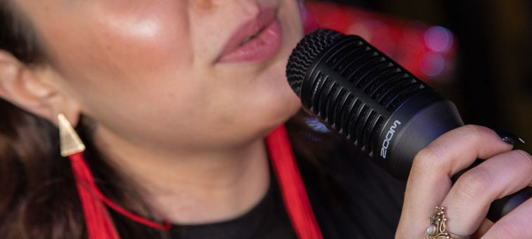 Close up of person singing into microphone