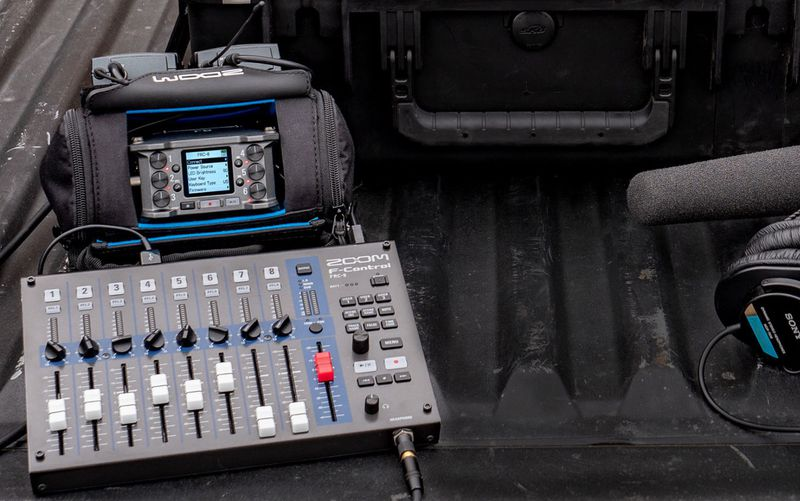 f6 paired with mixer, placed in a pickup truck bed with other gear & equipment.