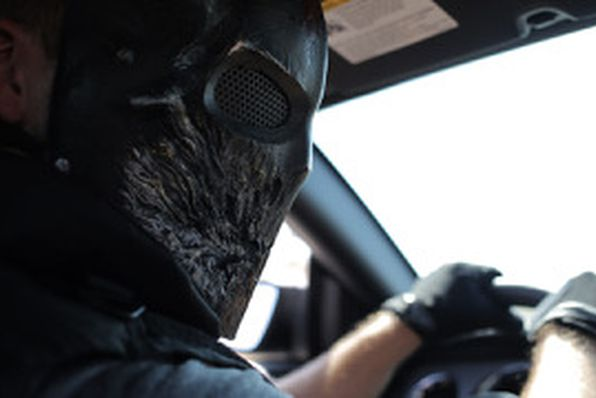 Stephen Ford driving car with bandana over his face