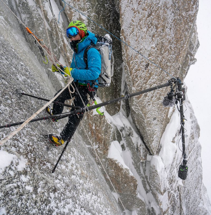 Jon Griffith prepares for 360º video productiono on a face of shear rock, Mount Everest.