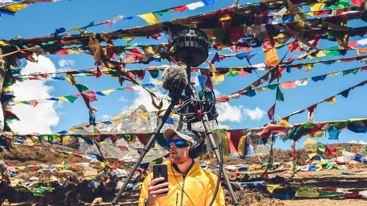 Martin Edström monitors sound from his H3-VR during 360º video production at Mount Everest.