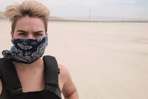 Stephen Ford in desert with bandana over his face