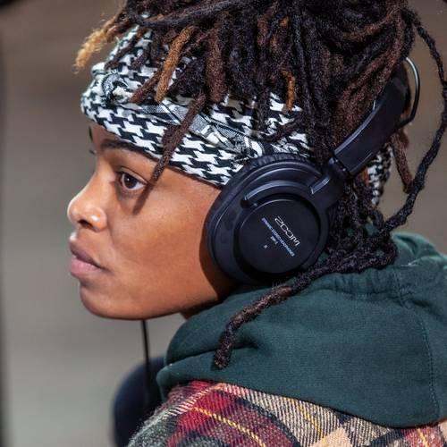 Podcaster wearing headphones