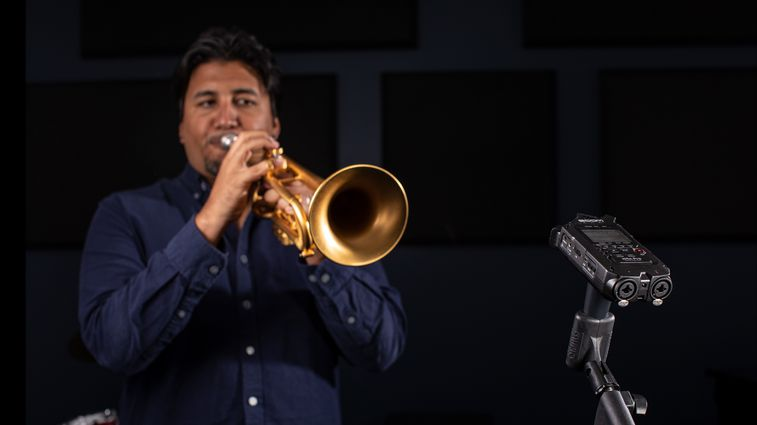 Trumpeter, Mike Rodriguez, playing into a H4n Pro in the studio.